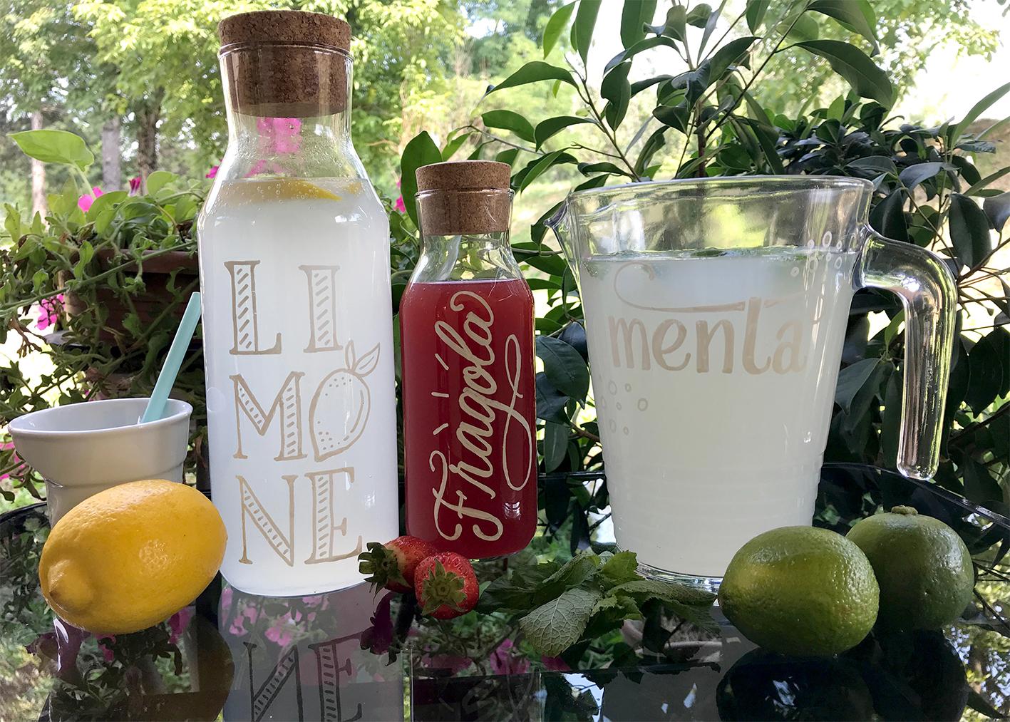 Scrivere lettering sulle bottiglie di vetro