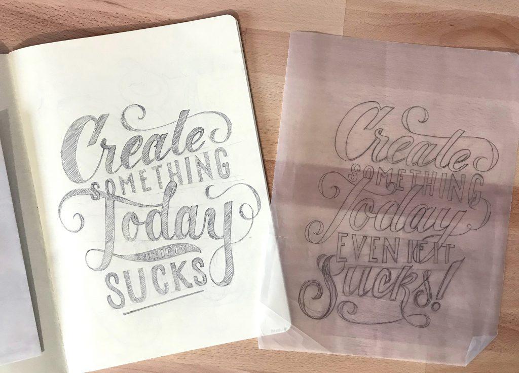 Bozze a matita di una scritta in lettering